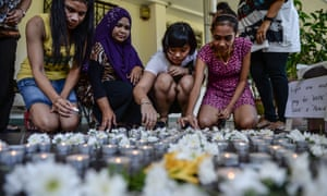 School teachers put candles on the floor to the missing passengers in Petaling Jaya on the second anniversary of MH370's disappearance.