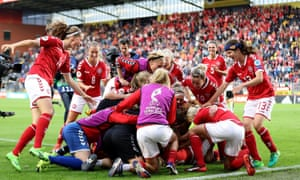 Denmark's players pile on top of their goalkeeper, Stina Lykke Petersen, as they celebrate reaching the Euro 2017 final.