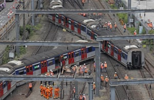 MTR staff stand at the site of a derailed train near Hung Hom station in Hong Kong on Tuesday.