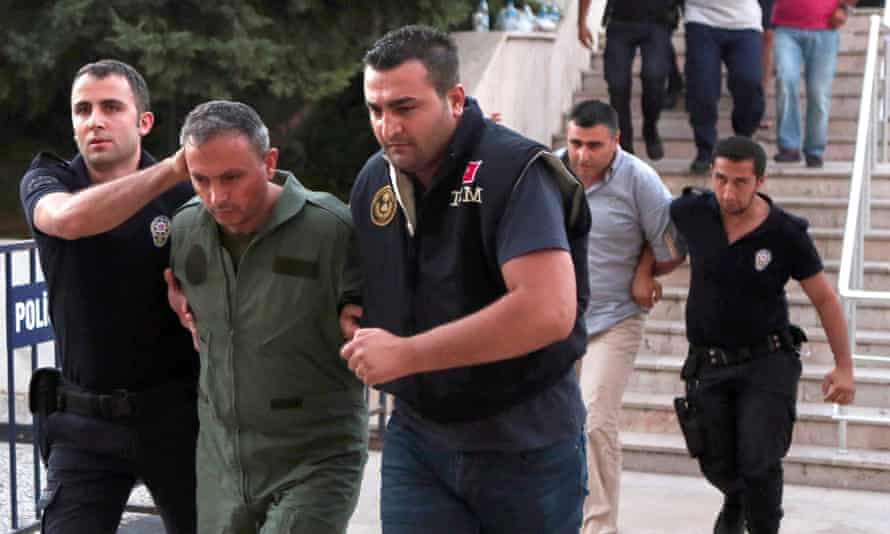 Members of Turkey's failed miltary coup are taken to the courthouse in Mugla.