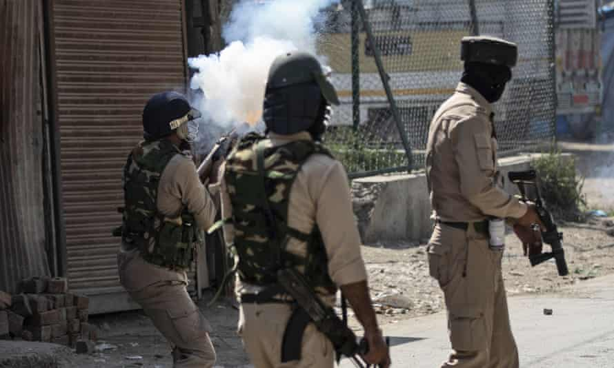 Indian police respond to protests in Kashmir.