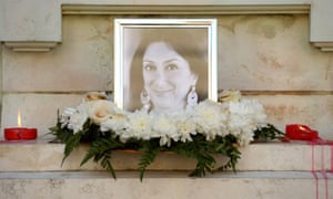 Flowers and tributes to Daphne Caruana Galizia at the foot of the Great Siege monument in Valletta, Malta, turned into a temporary shrine for the journalist, who was killed by a car bomb on 16 October 2017.