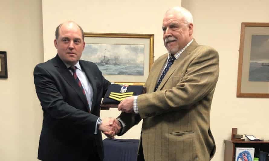 Falklands veteran Joe Ousalice, 68, being given back his medal for long service and good conduct by the defence secretary, Ben Wallace.