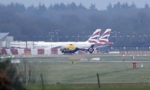 A police helicopter flies over Gatwick airport as the airport remains closed.