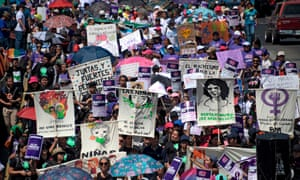 Women march to celebrate the International Women's Day in San Salvador, on March 8, 2019.