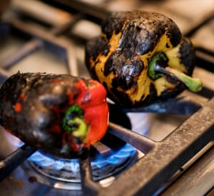 Capsicums blackening on a stovetop
