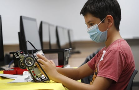 Sixth-grader Salih Tas builds a robot at a summer camp in Wylie, Texas.