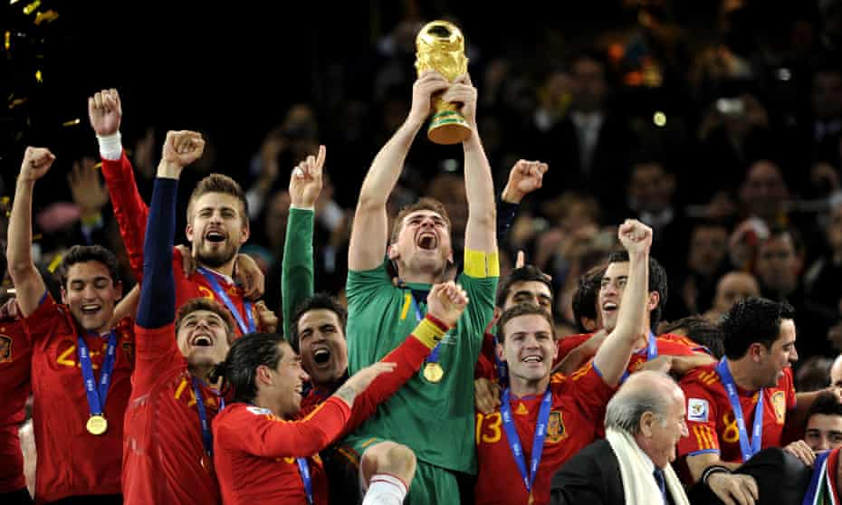 Spain celebrate winning the 2010 World Cup with Sepp Blatter.