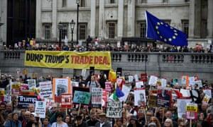 Demonstrators take part in an anti-Trump protest in Trafalgar Square.