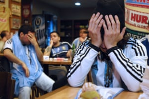 Buenos Aires, Argentina Dejected football fans react as their national side lose the Copa America final to Chile after a penalty shootout
