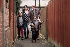 Still from Ken Loach's 2016 film I, Daniel Blake, showing Briana Shann, Hayley Squires, Dave Johns, Dylan McKiernan