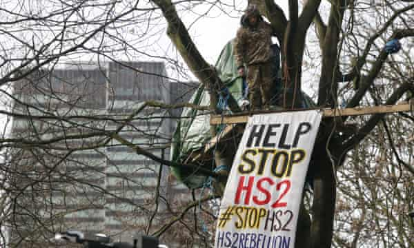 A protester in a tree house at the HS2 protest camp outside Euston station, London.