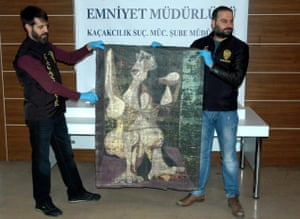 Turkish police in Istanbul hold-up an original painting by Pablo Picasso, Woman Dressing Her Hair, which they recovered on Saturday.