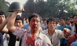 Blood-stained demonstrators in Tiananmen Square