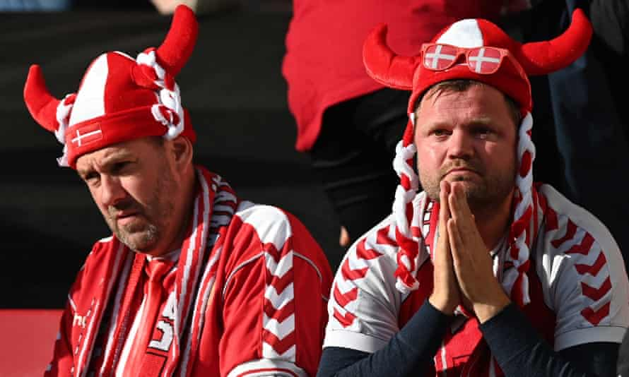 Denmark fans in Copenhagen look shocked by the medical emergency involving Christian Eriksen on Saturday during the match against Finland
