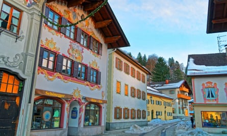 Cozy street with different colours of painted facades of the houses in Garmisch-Partenkirchen