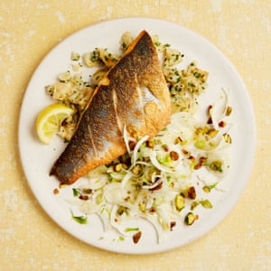 Yotam Ottolenghi's grilled sea bass with crushed celeriac and fennel and pistachio salad.