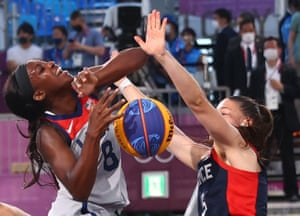 Marie-Eve Paget of France (right) blocks a shot by Jacquelyn Young of the United States.