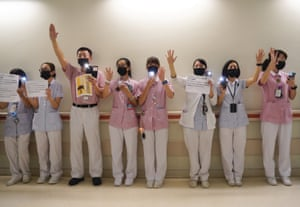 Hong Kong, China: Medical workers hold up five fingers signifying the five demands of protesters