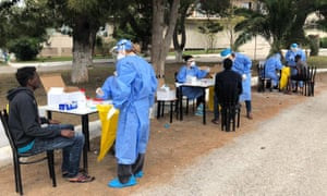 A photo from the Greek Organisation for Public Health reportedly showing refugees from Somalia and Sudan being tested for coronavirus in Kranidi, Peloponnese
