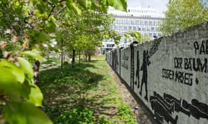 Flowers and trees are in bloom at the Berlin Wall memorial site 'Parliament of Trees' between Bundestag and House of the Federal Press Conference in Berlin, Germany.