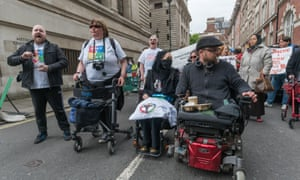 Disabled people protest about cuts to benefits.