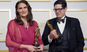 Alice Doyard, left, and Anthony Giacchino pose with the award for best documentary short, Colette.