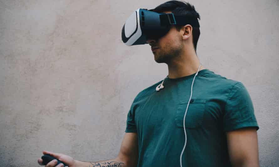 Man uses VR headset and remote control
