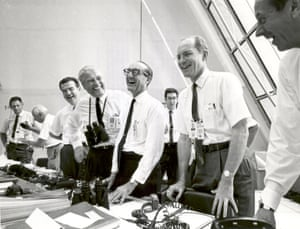 Apollo 11 mission officials relax in the launch control centre after the successful liftoff on 16 July 1969