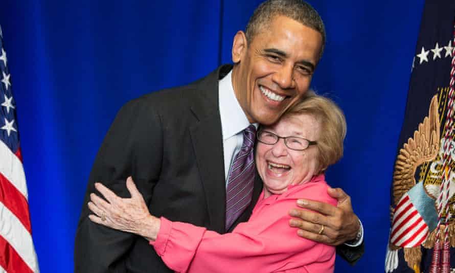 President Barack Obama greets Dr. Ruth Westheimer on a stage