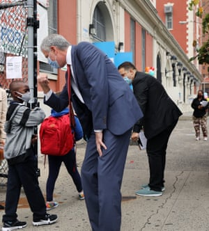 New York City Mayor Bill de Blasio elbow bumps a student as elementary school students returned to the city's public schools for in-person learning.
