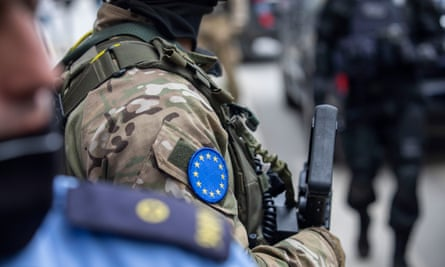 EU police during the arrest of an official from the KLA veterans' association in Pristina last week