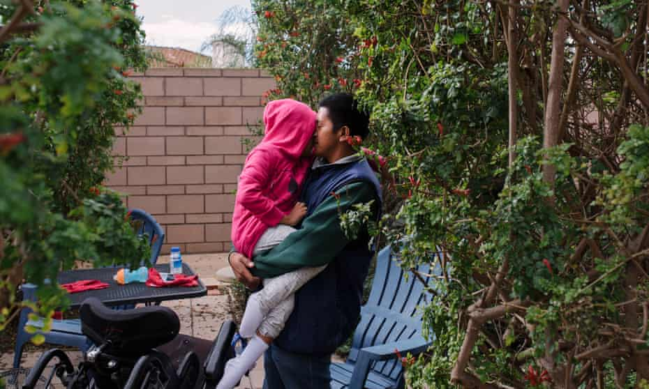 Juan Antonio shares a quiet moment with his daughter Lesly after feeding her lunch.