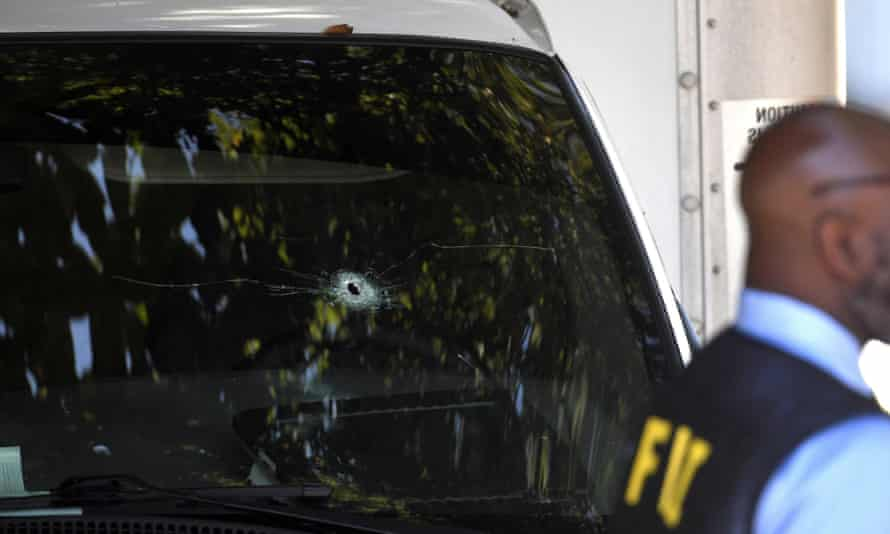 A bullet hole can be seen in the front window of a truck after a man was shot while fleeing Ice agents in Nashville, Tennessee