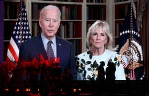 In this image US president Joe Biden and first lady Dr. Jill Biden speak via a video project onstage during Vax Live.