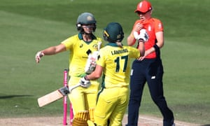 Australia's Meg Lanning and Ellyse Perry celebrate at the end of the match.