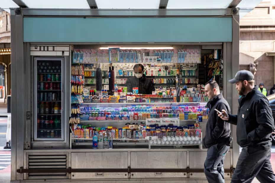 A newsstand stays open – but many shops and business have been forced to close.