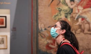 """A woman wearing a face mask visits the exhibition """"Raffaello 1520-1483"""" in Rome. The """"Raffaello 1520-1483"""" exhibition, the largest-ever retrospective of the life and work of Renaissance maestro Raphael, reopened to public recently at the Scuderie del Quirinale in Rome. Visitors, who had to wear face masks, were required to reserve precise entry times. Each visitor had his or her temperature taken by a digital thermometer upon entry."""