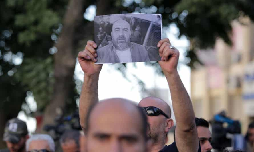 Palestinians take part in a protest aganist the death of Nizar Banat in the West Bank city of Ramallah on Sunday.