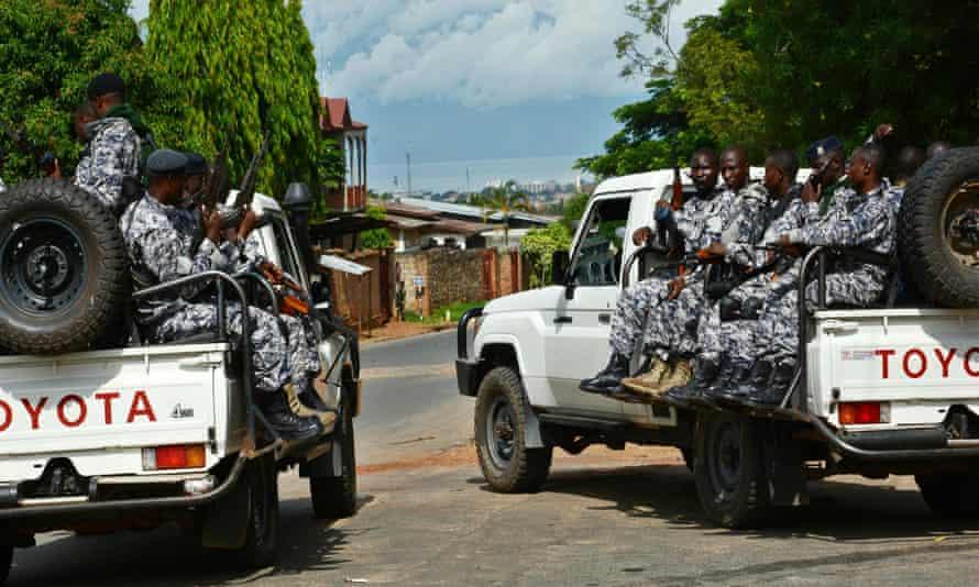 Burundian security officers secure the scene of a grenade attack in Bujumbura that killed Brigadier General Athanase Kararuza on 25 April 2016