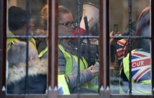 London, England Demonstrators wearing yellow vests protest inside of the offices of the attorney general