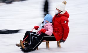 Families enjoy fresh snow at Volkspark Schoeneberg-Wilmersdorf in Berlin despite the Covid-19 contact restrictions in place.