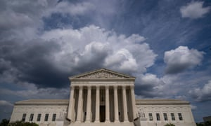 Clouds are seen above the US supreme court building in Washington, DC