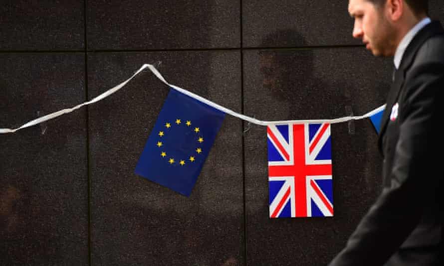 An European flag and a British flag.