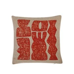 Beige cushion with orange patterns