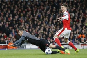 Arsenal's Laurent Koscielny tussles with Bayern Munich's Robert Lewandowski to concede a penalty.