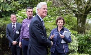 Michel Barnier with two other men turning away after shaking Lisa O'Carroll by the hand