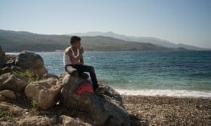 A teenage refugee, who lost his father and brother in the war and is living on Samos with his mother.
