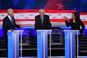 Kamala Harris fiercely debates Joe Biden during the first round of Democratic primary debates, as a rather stunned Bernie Sanders listens in the middle