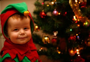 Naughty or nice? A Child dressed as a Christmas elf.